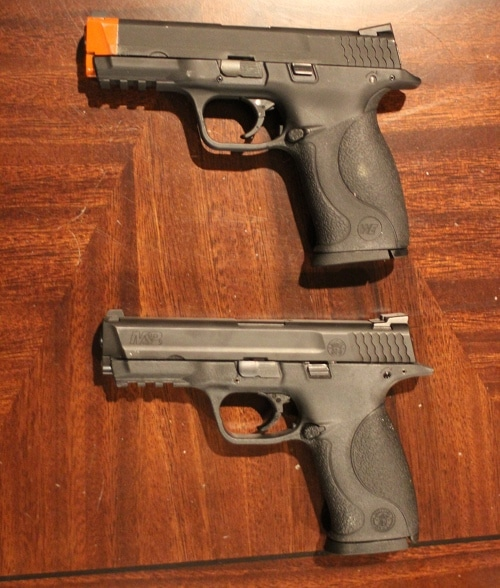 Airsoft pistol compared to real pistol.