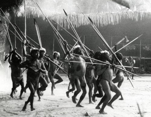Yanomamö tribesman dancing with spears