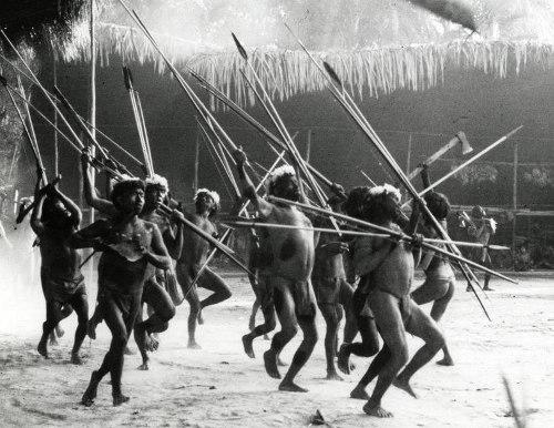 Yanomamö tribesman dancing with spears