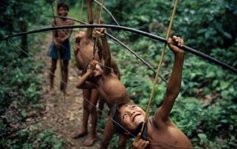 Yanomamö children boys training with bow and arrow