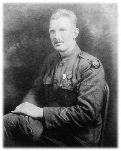Military soldier Alvin York portrait sitting in chair.