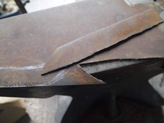 How to make a knife from an old saw blade the art of manliness step 4 bust out the blade greentooth Gallery