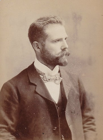 vintage portrait man in suit with bowtie full beard mustache