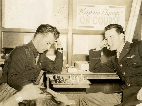 Vintage young men playing chess.