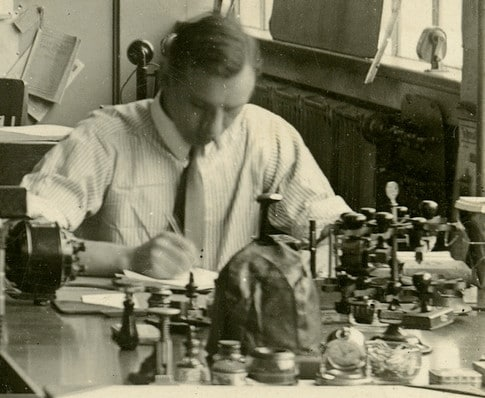 vintage scientist taking notes at laboratory lab table