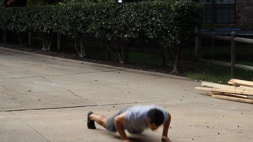 Vintage man laying on earth for pushups.