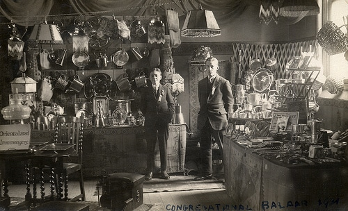 vintage young businessmen standing in their store shop