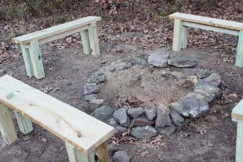 Vintage four benches placed on earth.