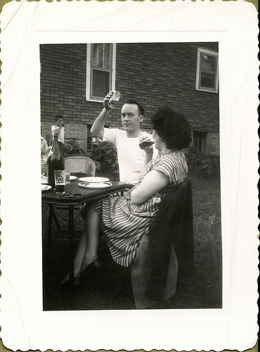 vintage man raising beer for toast outside