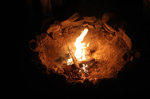 Fire is burning in the campfire.
