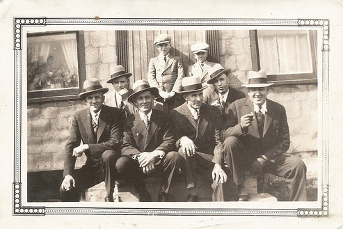 vintage group of men friends posing for photo cigars suits fedoras