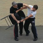 Krav Maga Technique of the Month: Defending a Two-Handed Overhead Chair or Stool-Type Attack