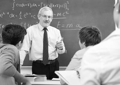 Vintage professor front of class teaching physics science class.