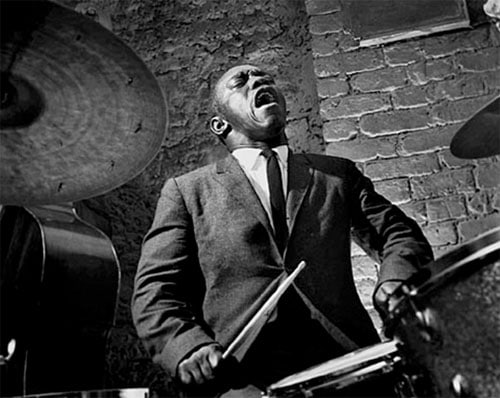 Art Blakey jazz musician playing drums singing.