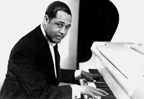 Duke Ellington jazz musician playing piano.