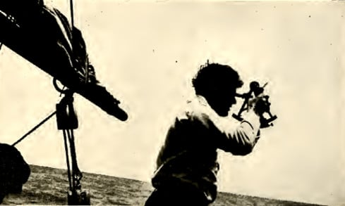 jack london on sail boat looking out over sea water