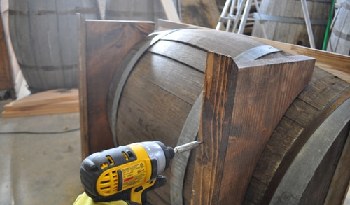 Whiskey barrel table legs attaching.