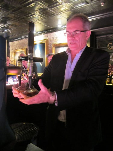 Guinness Master Brewer Fergal Murray pouring Guinness beer.
