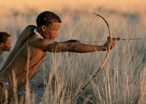 Bushmen young boy hunter with spear hunting gear.
