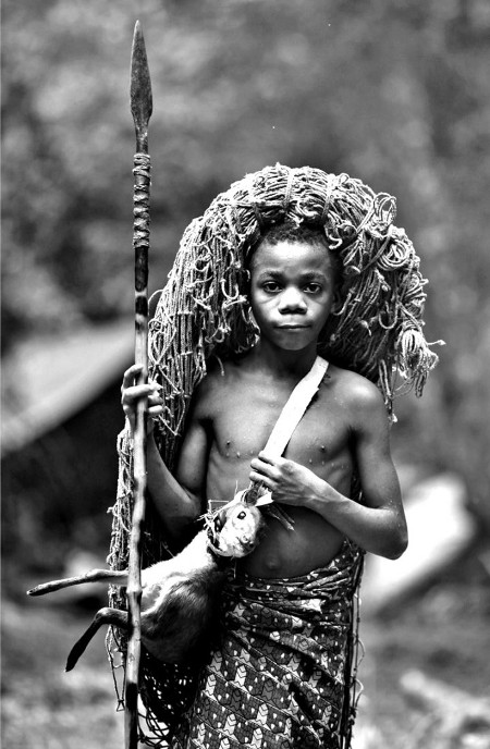 Vintage african young boy with spear hunting gear.