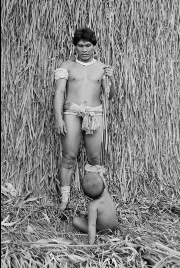 Vintage man standing without wearing dress with little baby.