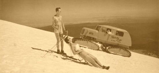 vintage man and woman on ski slope sun bathing