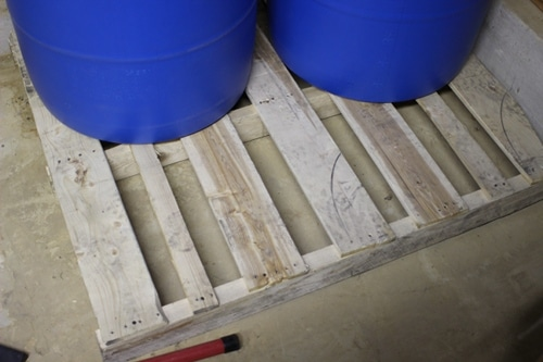 water barrels on a wood pallet