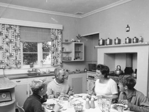 vintage family at dinner table in home