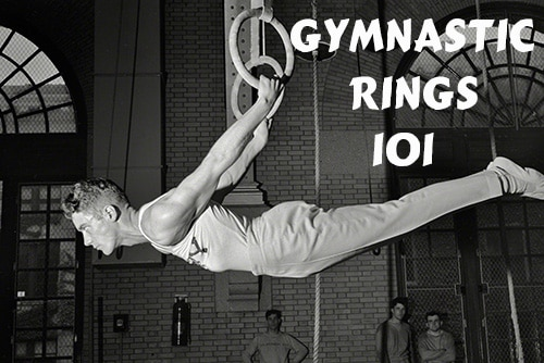 vintage gymnast hanging on gymnastic rings