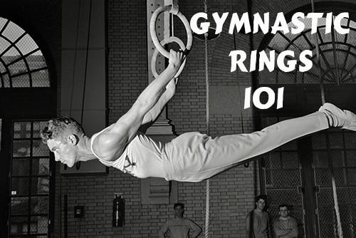 vintage gymnast hanging on gymnastic rings