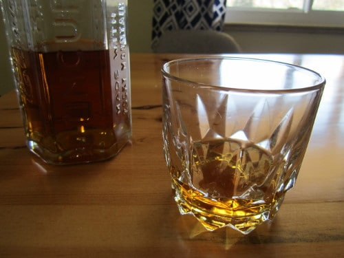 tin cup whiskey in old fashioned rocks glass