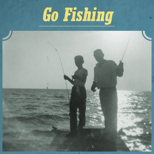 vintage father and son fishing off dock silouhette