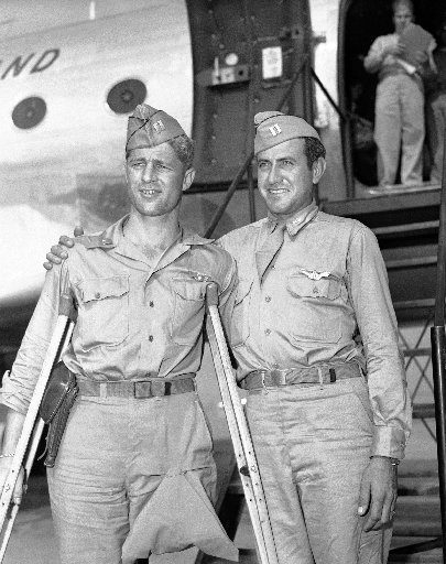 Louis Zamperini, Fred Garrett posing in uniform in front of plane