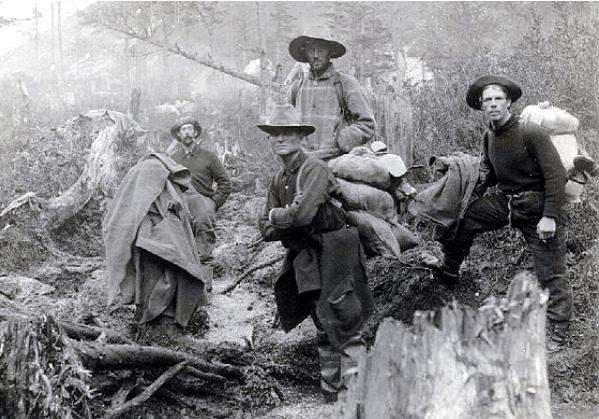 vintage men in woods with hats rucksacks outdoor gear