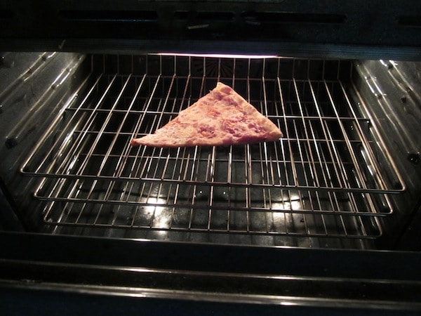 reheating pizza in an oven