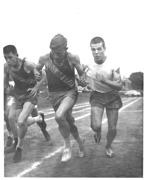 vintage young men running track mile race
