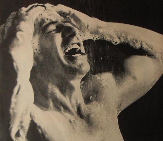 vintage man in shower suds lathering head black white photo