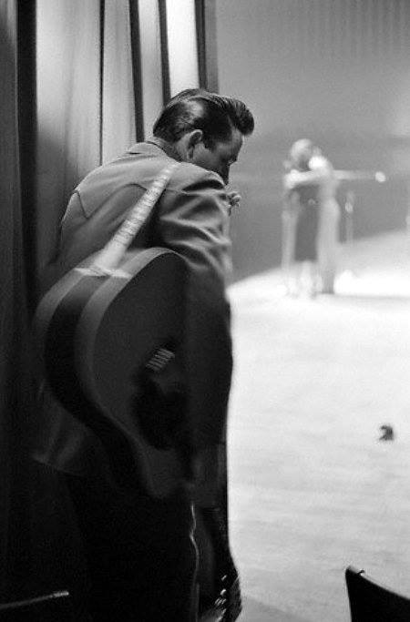 johnny cash with guitar backstage before going out for a show