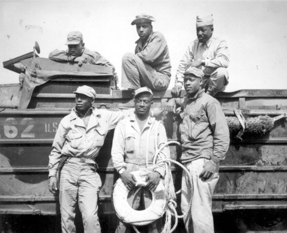 vintage african american soldiers photo in front of truck