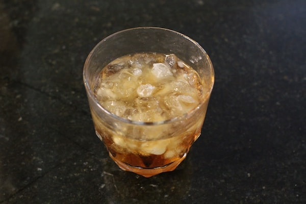 whiskey in glass of crushed ice