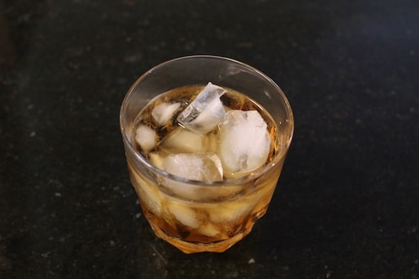whiskey in glass of standard ice cubes