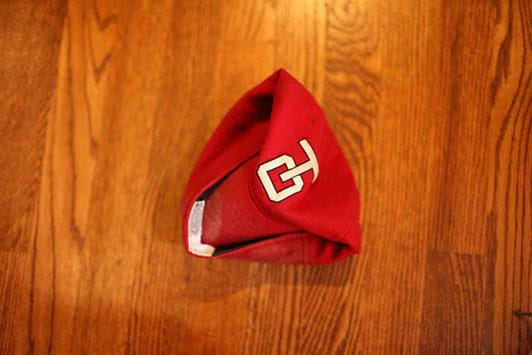 Folding a baseball cap.