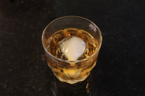 whiskey glass with large ice ball