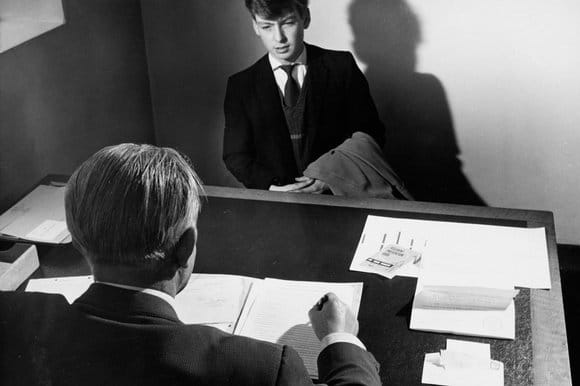 vintage young man in job interview at desk