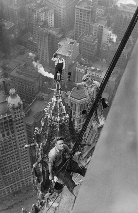vintage construction workers at top of new york skyscraper