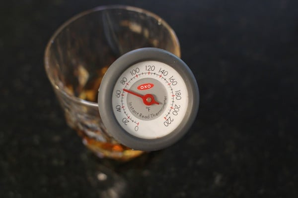 oxo thermometer in whiskey glass measuring temperature