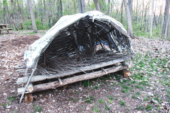 An emergency shelter bed in forest.