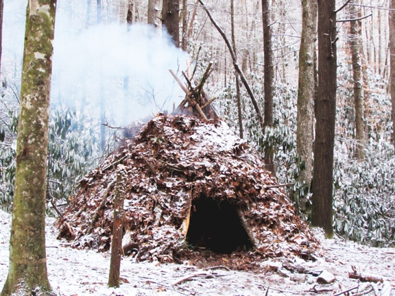 wiki-up-style shelter with an internal fire ring