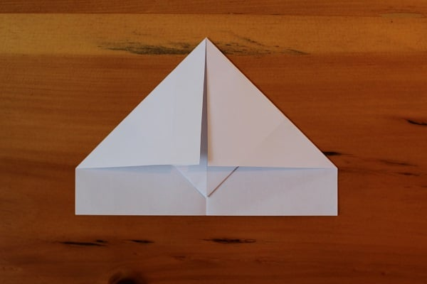 Step 4 — Fold top corners down again, towards middle crease.