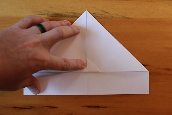 Step 5 — Fold up the small triangle that was left over from the previous step.